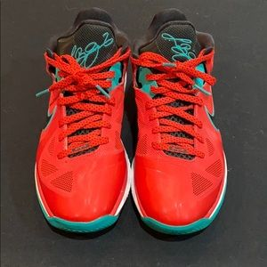 Red lebrons with printed signature on the tongue